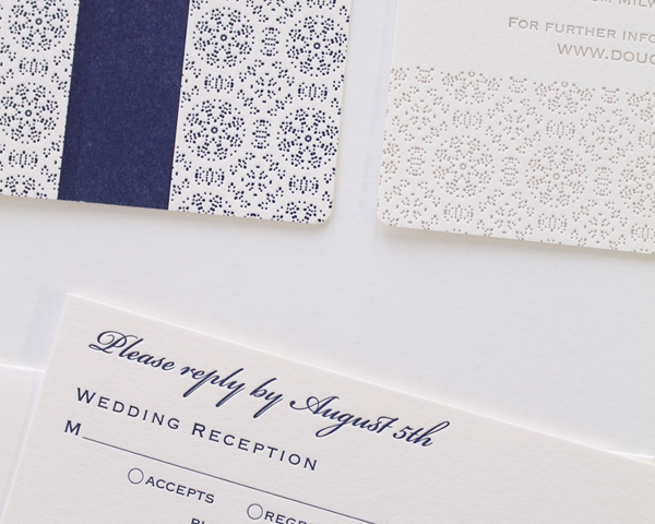 custom letterpressed wedding invitation denver colorado blue and white snowflakes navy belly band patterned border