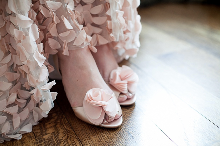 Blush wedding dress and shoes from Emma & Grace